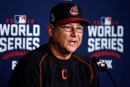 Indians exercise options manager Francona, slugger Santana