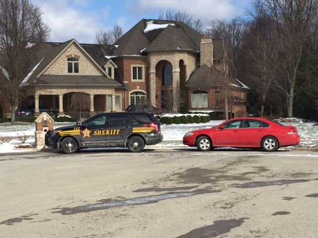 A Mahoning County Sheriff's cruiser parked outside Marchionda's Poland home