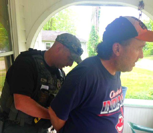 William Casey being arrested