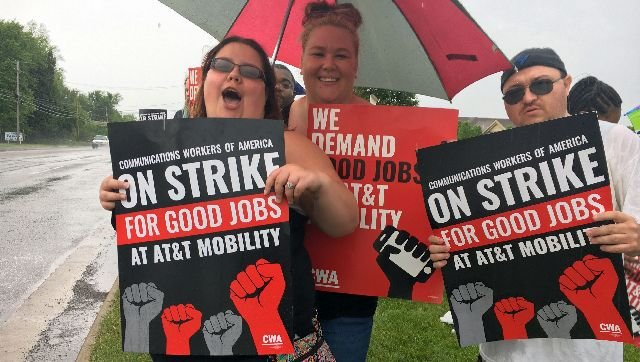 Strikers march outside the AT&T call center on South Ave. in Boardman