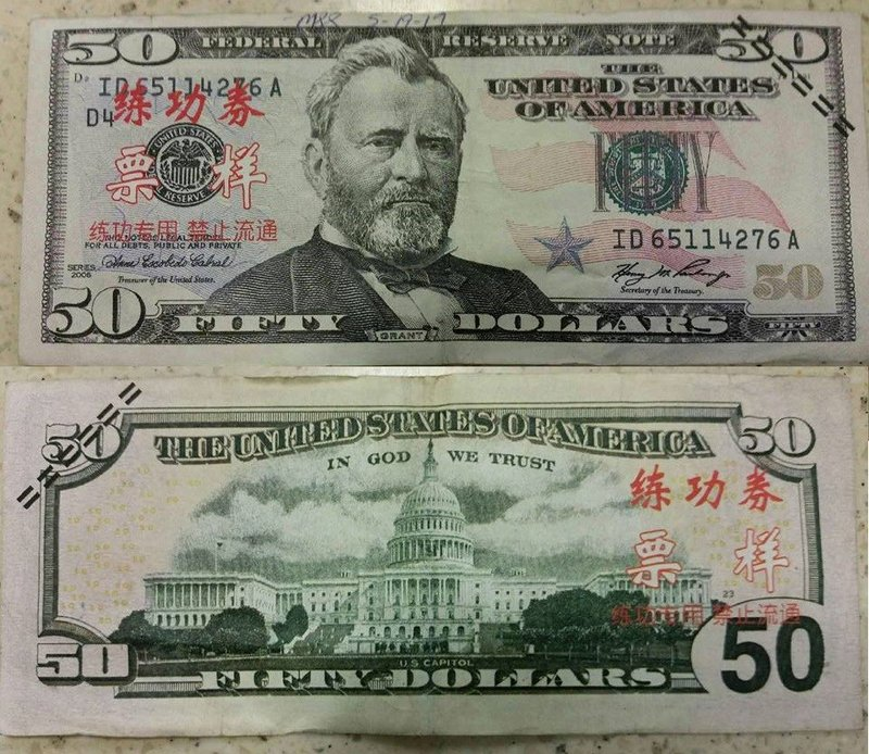 Counterfeit bills marked with Chinese letters being circulated