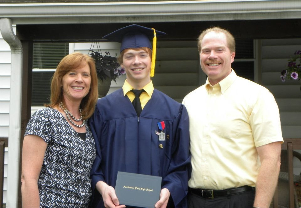 Daniel Ferguson and his parents when he graduated from Austintown Fitch in 2012