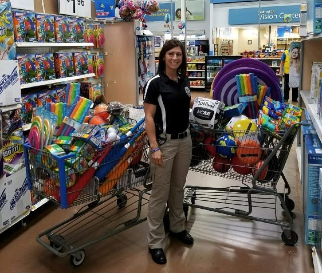 A Farrell police officer stands with the reward toys.
