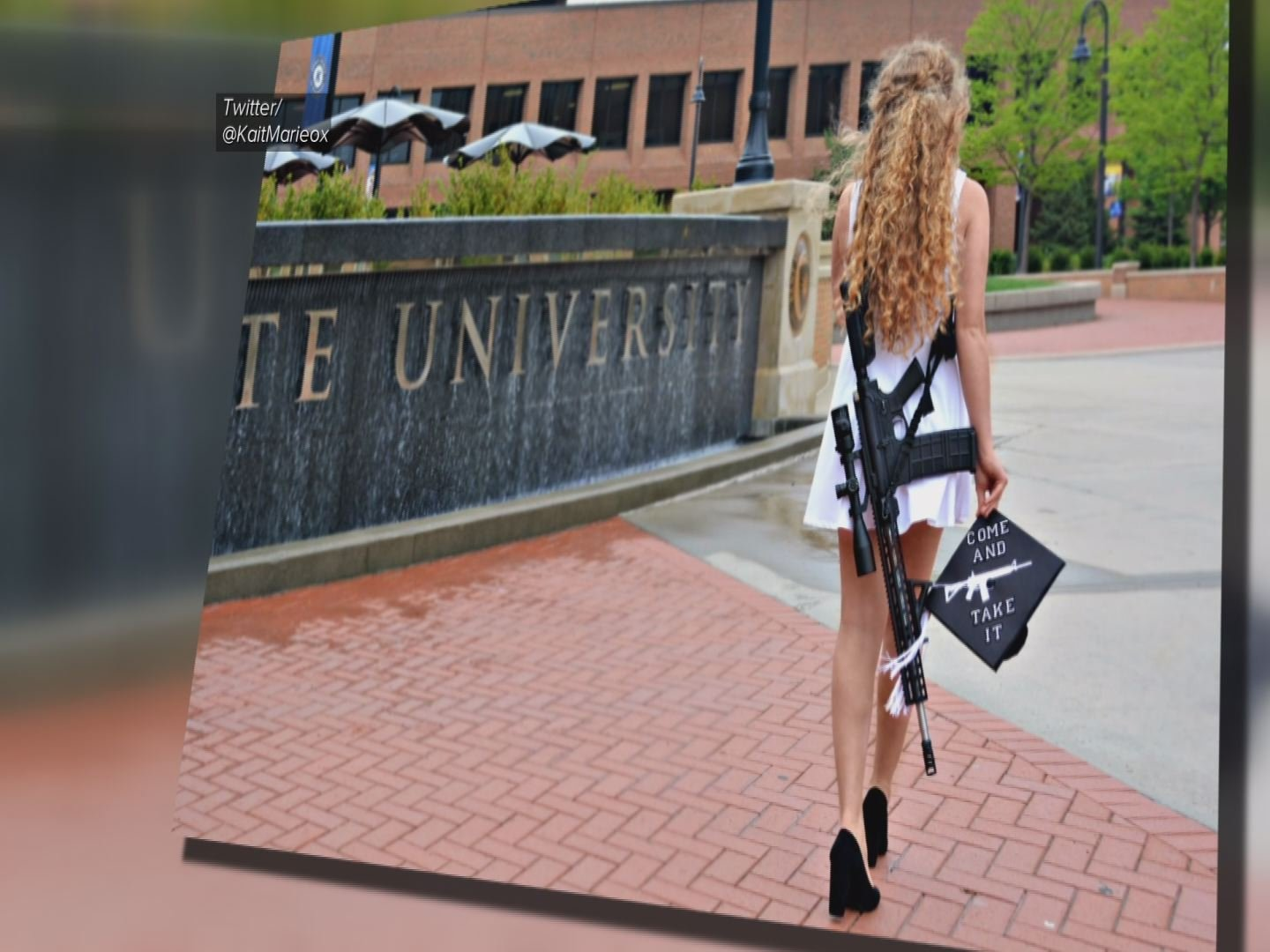 Graduate's photo carrying rifle goes viral