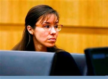 (AP Photo/The Arizona Republic, Rob Schumacher, Pool). Defendant Jodi Arias looks to her family during closing arguments during her trial on Friday, May 3, 2013 at Maricopa County Superior Court in Phoenix.