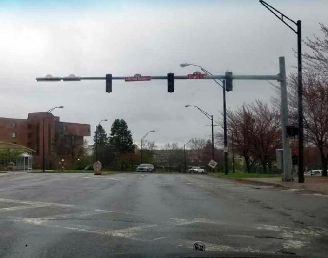 Darkened traffic lights hang over 5th Ave. near YSU