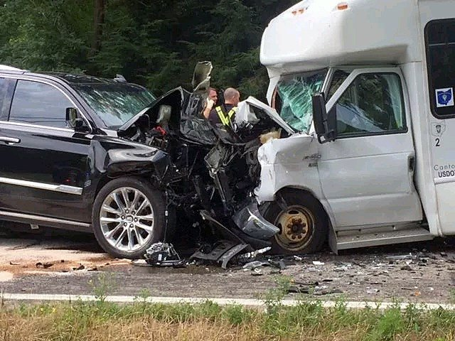1 dead after 2 SUVs and 'special needs' bus collide in
